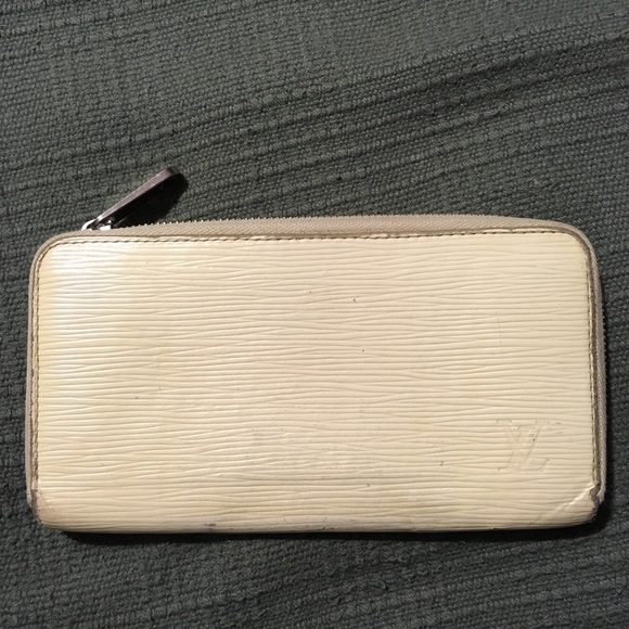 ee131336d76b Louis Vuitton Handbags - LV cream epi leather zippy wallet